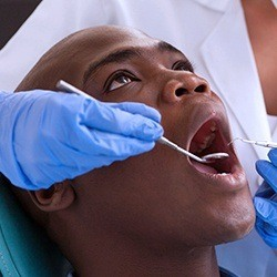 man getting oral cancer screening