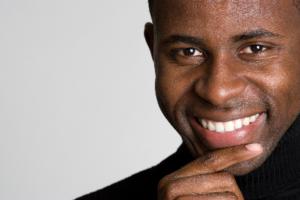 Man in black shirt smiling
