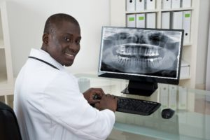 dentist reviewing dental images