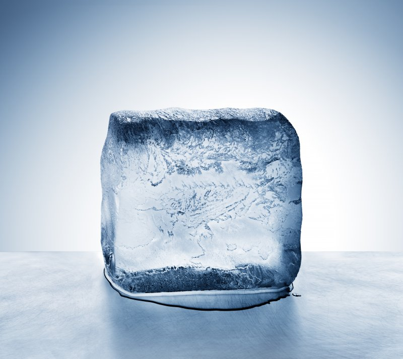 Ice cube on a cold surface