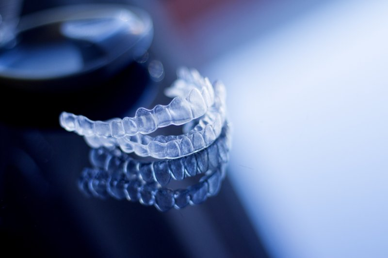 Pair of ClearCorrect aligners on a reflective table