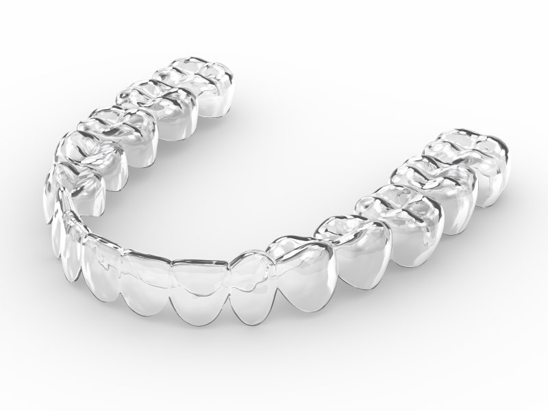 Clear aligners sitting on a white surface